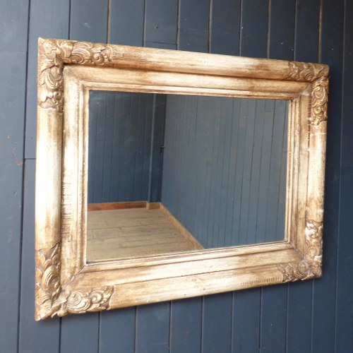 LARGE CREAM MIRROR IN HEAVY CARVED FRAME