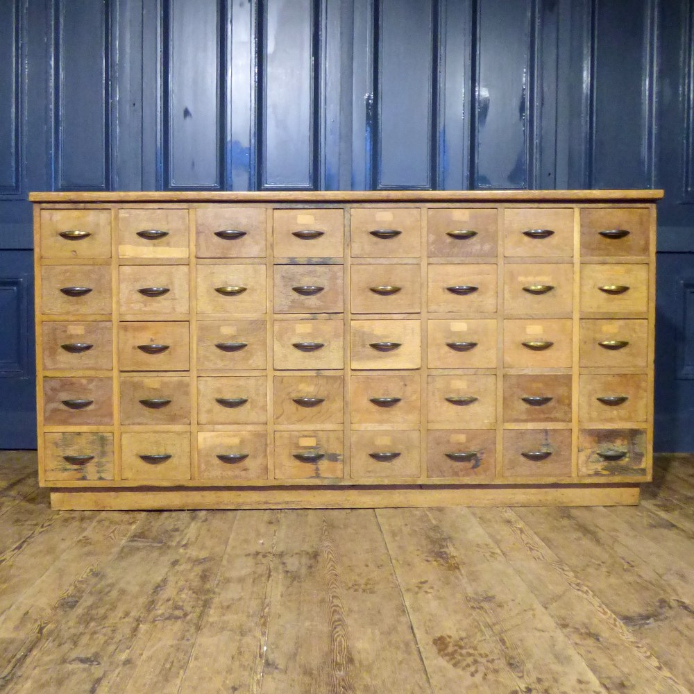 ANTIQUE OAK HABERDASHERY COUNTER BANK OF FORTY DRAWERS RWI4871
