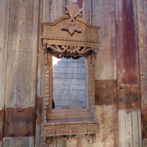 CARVED WOODEN MIRROR WITH SHELF AND DRAWER