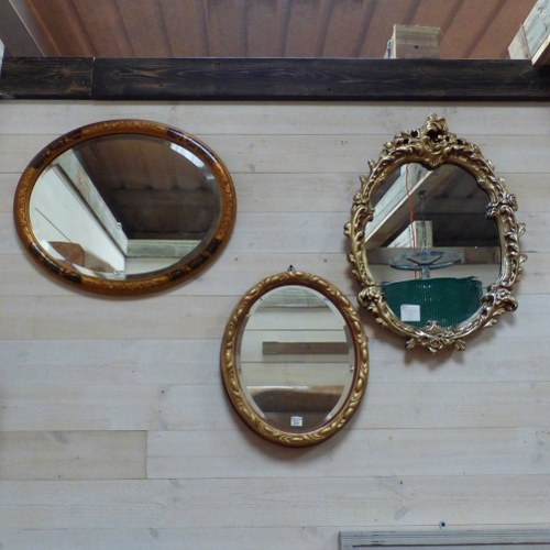 THREE GILT DECORATIVE GILT OVAL MIRRORS (PRICED INDIVIDUALLY)